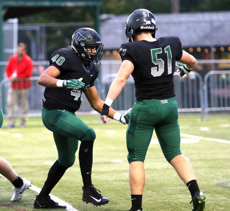 TIMES PHOTO: DAN BROOD - Tigard senoirs Noah Jackman (40) and Mitchell Cross were both All-Three Rivers League first-team selections on defense.
