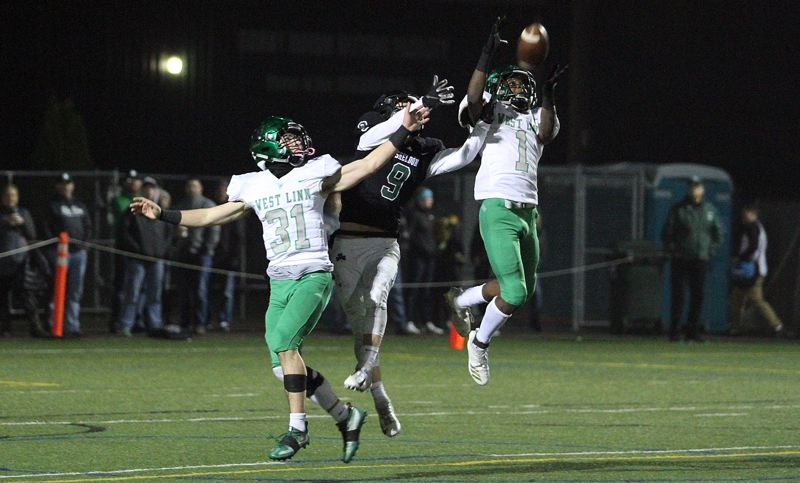TIDINGS PHOTO: MILES VANCE - West Linn's Dawson Jolley (right) and Max Jacobs defend a pass during their team's 38-26 loss at Sheldon in the Class 6A state quarterfinals Friday night.