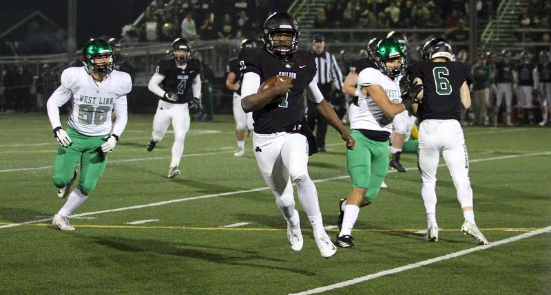 TIDINGS PHOTO: MILES VANCE - Sheldon quarterback Michael Johnson Jr. runs to daylight during his team's 38-26 win over West Linn in the Class 6A state quarterfinals at Sheldon High School on Friday.