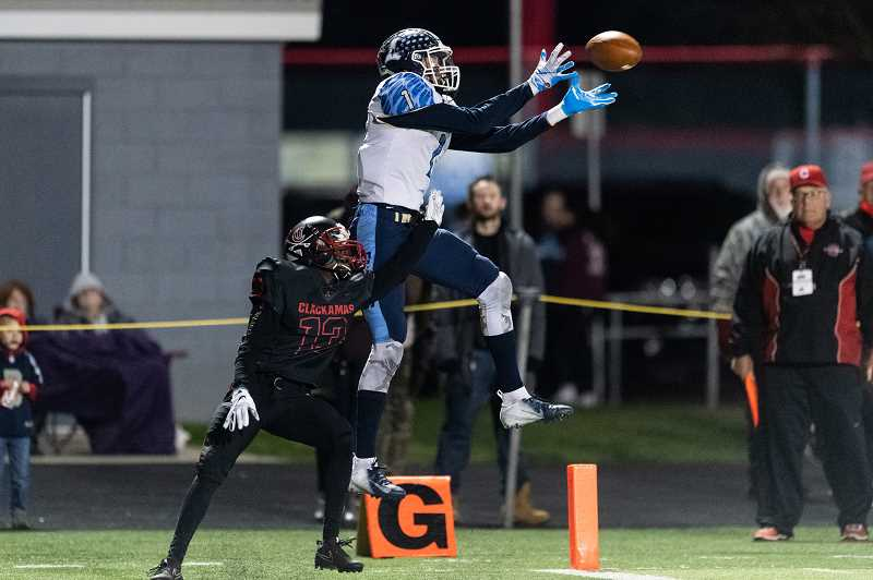 STAFF PHOTO: CHRISTOPHER OERTELL - Liberty's Marquis Brown goes up for a catch during the Falcons' game against the Cavaliers, Nov. 16, at Clackamas High School.