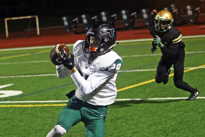 TIMES PHOTO: DAN BROOD - Tigard senior Luke Ness makes a catch on the right sideline during Friday's game at Jesuit.