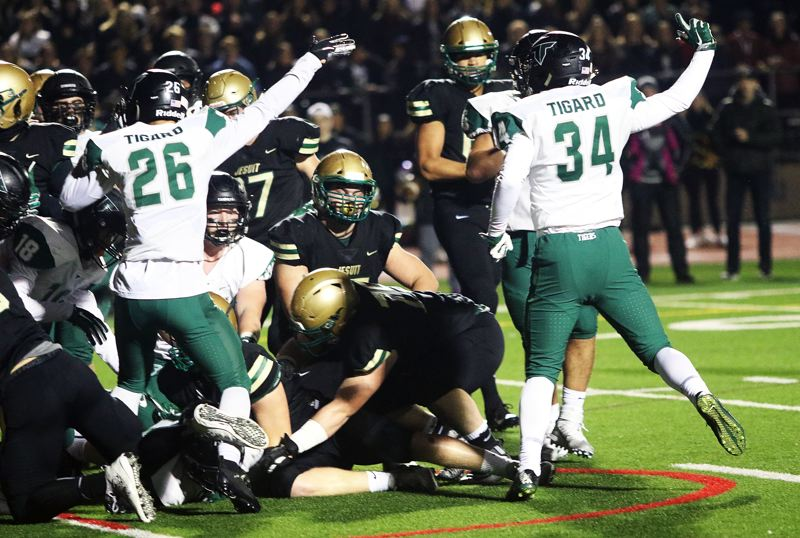 TIMES PHOTO: DAN BROOD - The Tigers point up field after senior Mitchell Cross recovered a Jesuit fumble on the Tigard 1-yard line.