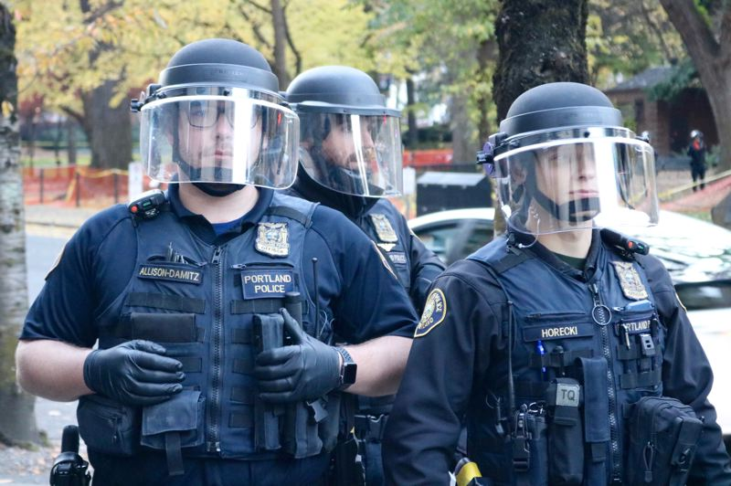 TRIBUNE PHOTO: ZANE SPARLING - Portland Police officers stand guard on Saturday, Nov. 17.