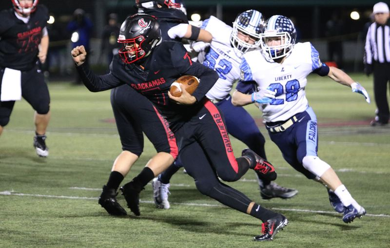 PAMPLIN MEDIA: JIM BESEDA - Clackamas quarterback Caleb 'C.J.' Jordan had 12 carries for 97 yards and two touchdowns and completed 5 of 7 passes for 164 yards and two more scores in Friday's 59-21 win over Liberty.