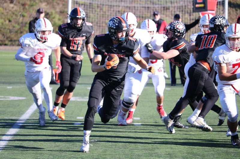 PAMPLIN MEDIA: JIM BESEDA - Gladstone's Spencer Boyd had 11 carries for 61 yards and caught three passes for 22 yards in Saturday's 23-19 loss to Seaside in the semifinals of the OSAA Class 4A football playoffs.