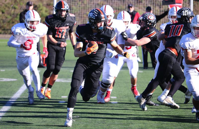 PAMPLIN MEDIA: JIM BESEDA - Gladstone senior tailback Spencer Boyd looks for running room on the Gladiators' opening drive in Saturday's OSAA Class 4A semifinal against Seaside at Hillsboro Stadium. Seaside won 23-19.