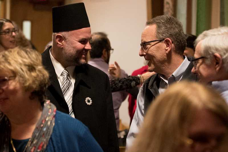 REVIEW PHOTO: JAIME VALDEZ - Abdulah Polovina, Imam at the Bosniaks Educational & Cultural Organization mosque in Portland, and Harvey Jacobs greet each other at Interfaith Service at the Lake Oswego United Church of Christ.