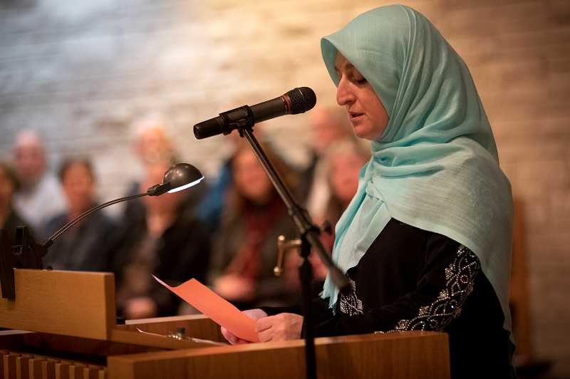 REVIEW PHOTO: JAIME VALDEZ - Beth Yazhari, a member of the Bahai Community, offers a reading of welcome at the Interfaith Service celebration at the Lake Oswego United Church of Christ.