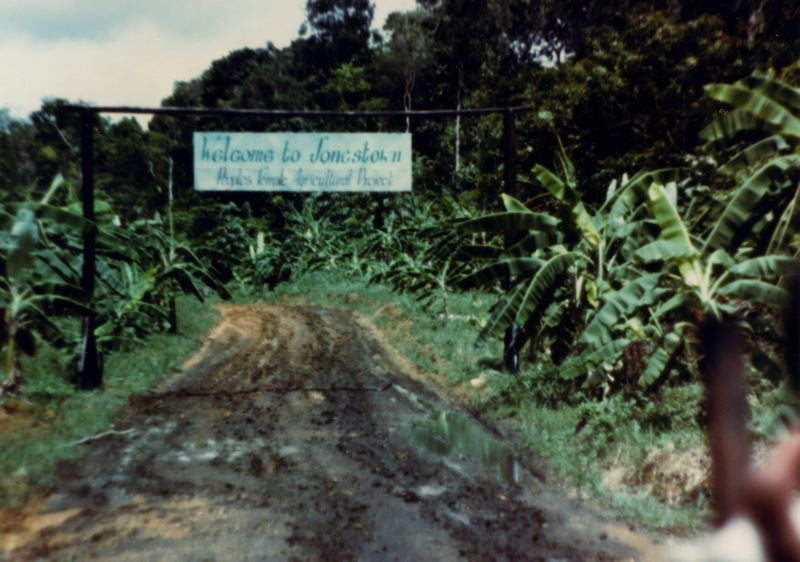 COURTESY PHOTO: JONESTOWN INSTITUTE AT SDSU - A photo of the Jonestown entrance in Northern Guyana includes the sign, 'Welcome to Jonestown, Peoples Temple Agricultural Project.' The project was site of a horrific suicide/murder of more than 900 people 40 years ago.