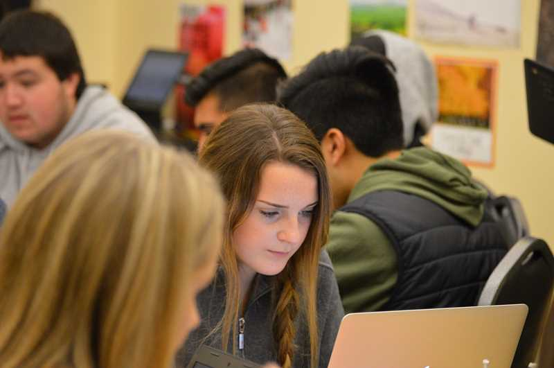 SPOKESMAN PHOTO: CLARA HOWELL  - Brooklyn James works on a college application for Gonzaga University.