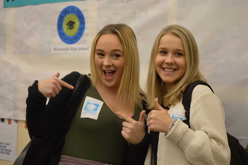 SPOKESMAN PHOTO: CLARA HOWELL  - Summer Johnson, left, and Sara Dyer participate in Oregon College Application Week.