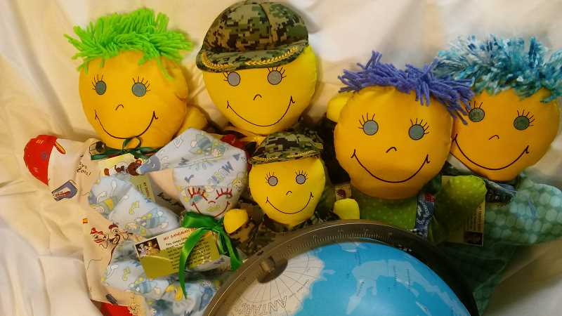 SUBMITTED PHOTO  - Trenee' Zweigle creates specialty stuffed dolls for kids with cancer.