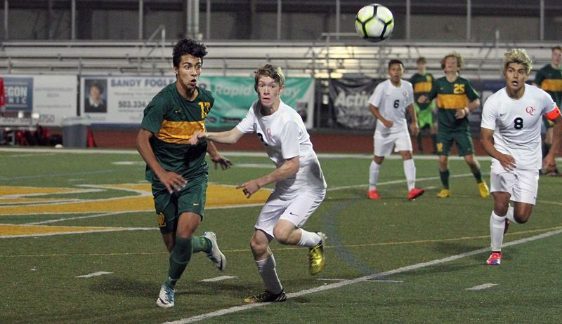 TIDINGS FILE PHOTO - West Linn senior midfielder Abdul Ali (left) was one of nine Lions honored on Three Rivers League all-star teams after helping lead his team to a TRL co-championship.