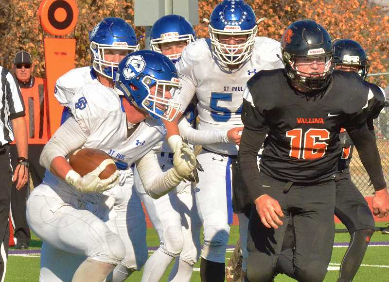 PAUL WAHL, WALLOWA COUNTY CHIEFTAIN - St. Paul senior Justin Herberger led all teams with 34 carries for 222 yards in the Buckaroos' 48-16 win over Wallowa in the 2018 1A Football State Semifinals.