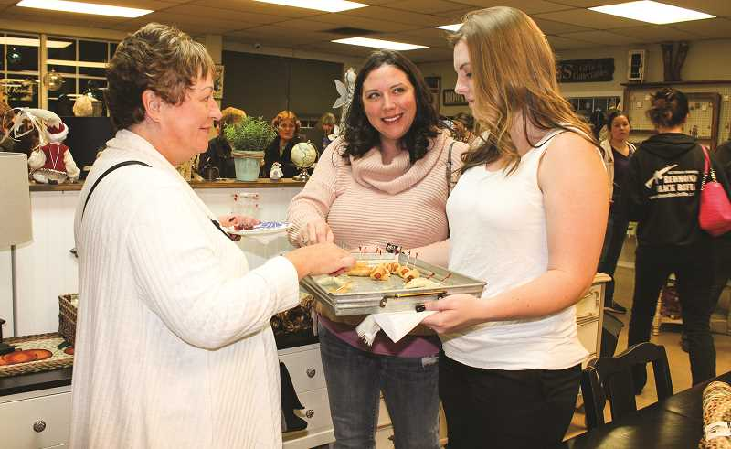 HOLLY SCHOLZ/CENTRAL OREGONIAN  - The Prineville-Crook County Chamber of Commerce encourages shoppers to visit local Chamber members during Small Business Saturday, this Saturday. Pictured, Judy Stonehocker, left, Jennifer Pence and Sierra Pence sample refreshments at Home Beautiful Oregon.