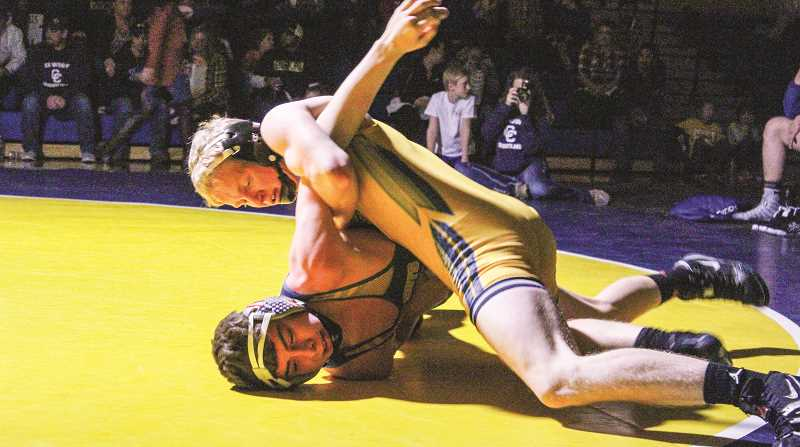 JASON  CHANEY/CENTRAL OREGONIAN  - Gage Match — Gage Perry tries to pin Gage Hanson during the 138-pound battle, the only match of the night that was not decided by fall as Perry claimed a victory by major decision.
