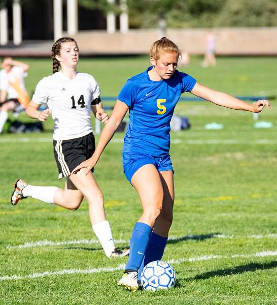 LON AUSTIN/CENTRAL OREGONIAN  - Gracie Kasberger takes a shot at goal during the Cowgirls' game against Dallas early in the year. Crook County won the game 9-0. Kasberger scored three goals in the match and seven on the year.