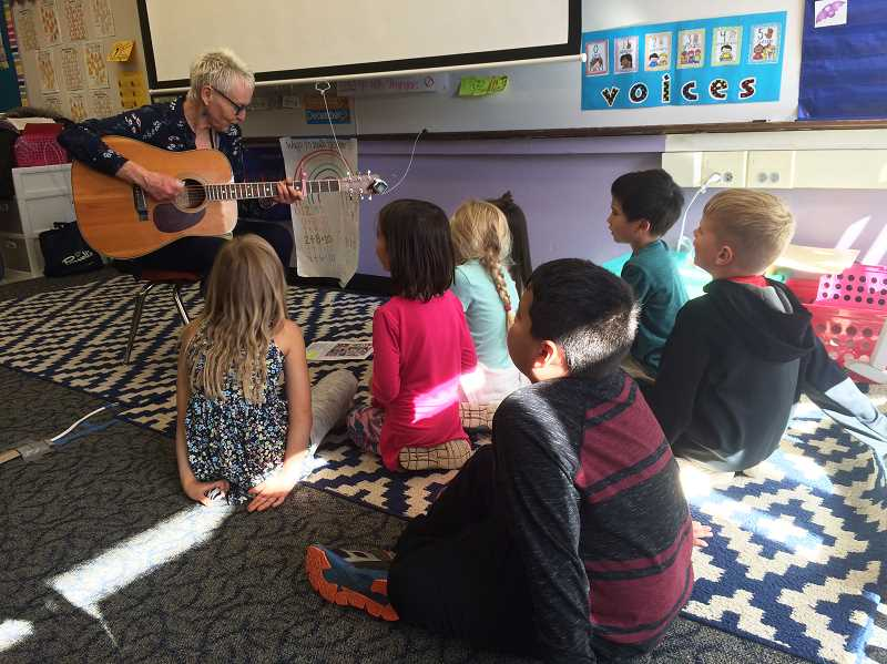 COURTESY PHOTO: SAM THOMPSON - Ellen Whyte leads a Carus first-grade class in song.