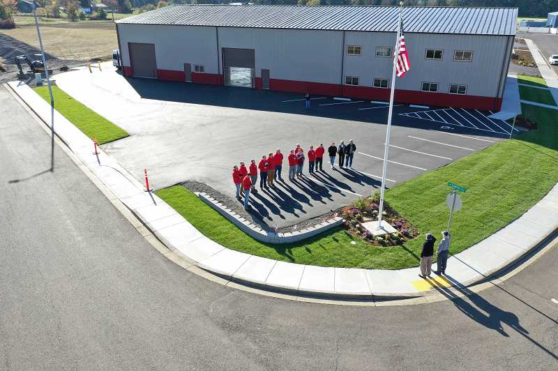 CONTRIBUTED PHOTO: SABRINA LA LONDE - Employees at La Londe Electric salute the recently-raised flag at the company in the Estacada Industrial Park.