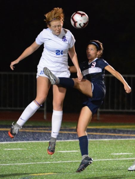 PAMPLIN MEDIA GROUP: DAVID BALL  - Some who coach girls soccer say young players have trouble directing the ball with their heads, so that limiting aerial play wouldnt affect the quality of competion very much.