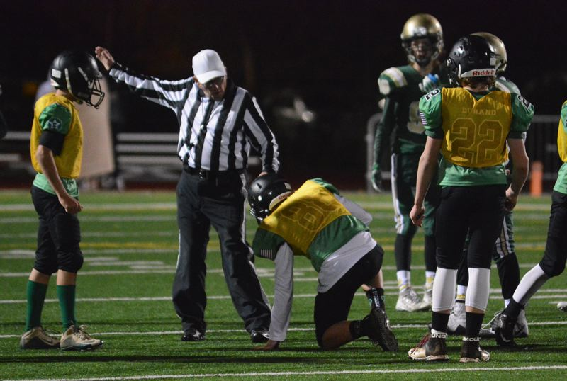 ESTACADA NEWS: DAVID BALL - The referee points in Estacadas direction after Von Maxon recovered a West Linn fumble in the fourth quarter.