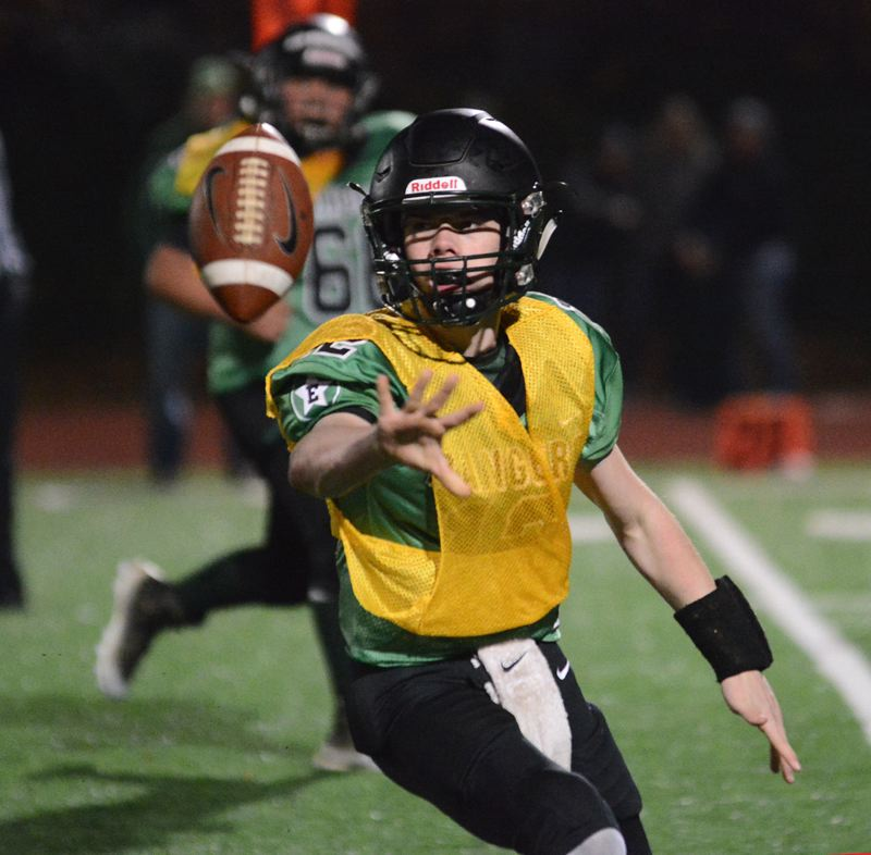 ESTACADA NEWS: DAVID BALL - Estacada QB Cory James pitches the ball toward the sideline for a first-down pickup on the Rangers opening drive of the second half.