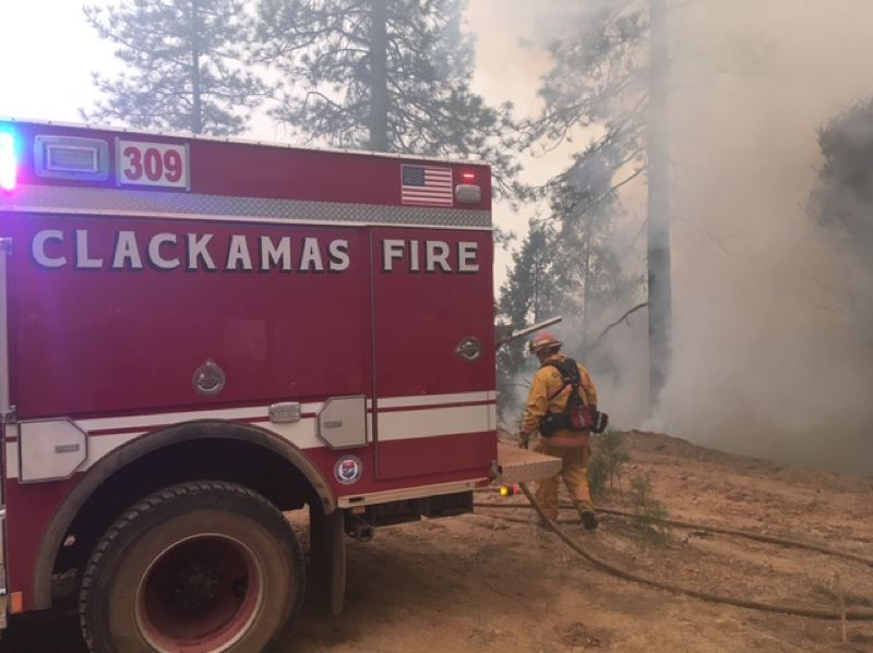 PHOTO COURTESY: CLACKAMAS FIRE - Clackamas Fire's Strike Team works with bulldozer teams to reinforce fire lines.