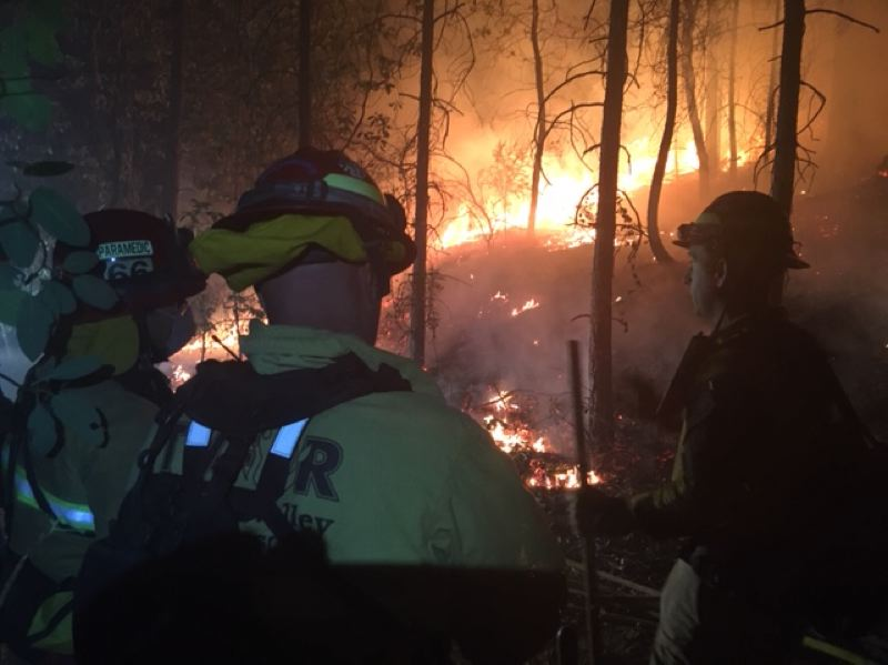 PHOTO COURTESY: CLACKAMAS FIRE - Clackamas firefighters continue to work shifts at the wildfire that has essentially destroyed the Northern California city of Paradise.