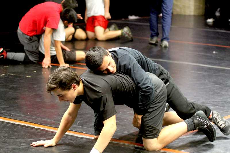 STEELE HAUGEN - Lorenzo Vasquez pracices his newly learned moves on his training partner. Vasquez is a state champion wrestling at 120 pounds.