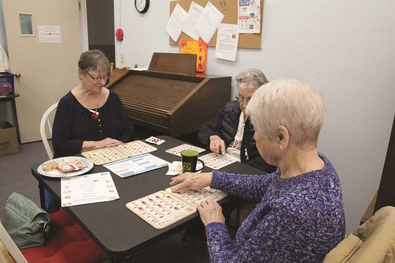 LINDSAY KEEFER - Local seniors take part in a bingo game on a Thursday afternoon at the Woodburn Senior Center, located in the Woodburn United Methodist Church.