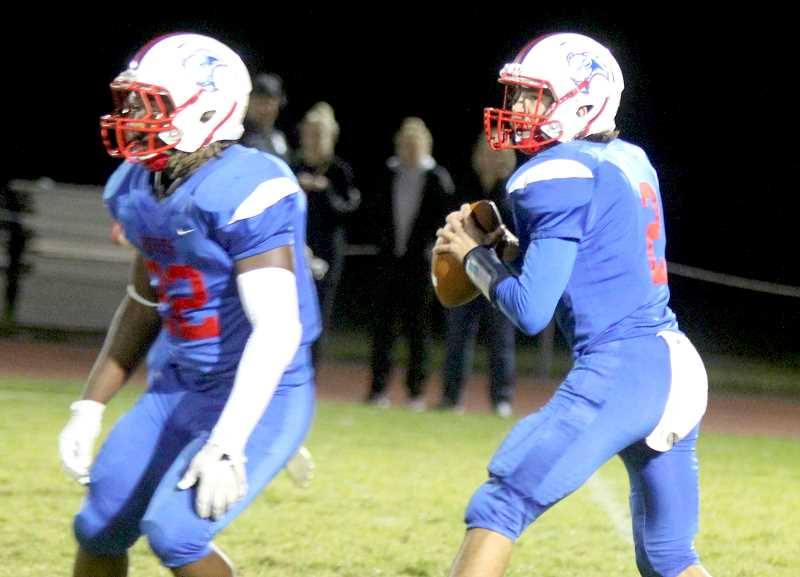 STEELE HAUGEN - At right, (2) Robert Pacheco throws for 459 yards to earn first-team quarterback. At left, Treyvonn Easterling (22) earns second-team runningback for Madras.