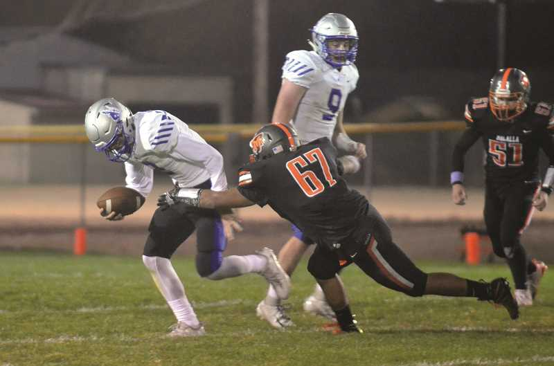ARCHIVE PHOTO: TANNER RUSS - Molalla senior Ricardo Gatica secures a tackle in the regular season.
