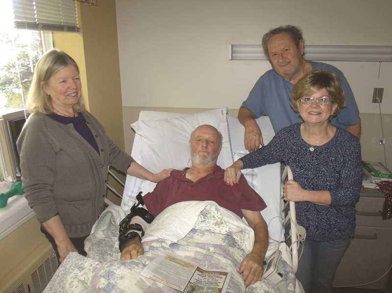 JUSTIN MUCH - Gervais arborist, Robert Nibler, recuperates at Providence Benedictine in Mount Angel while enjoying a visit from friends, Laura Harryman, left, Robert Hunt and Dawn Rogers. Nibler fell 20 feet onto pavement while trimming a sweetgum tree on Oregon Way in Woodburn on Oct. 9.