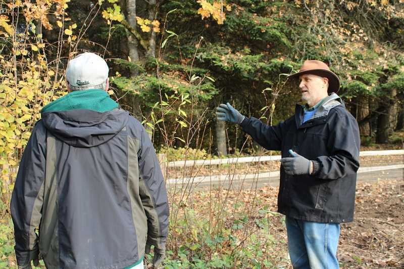 TIDINGS PHOTO: PATRICK MALEE - Dave Kleinke, right, talks to Michael Rutten about the pollinator garden.