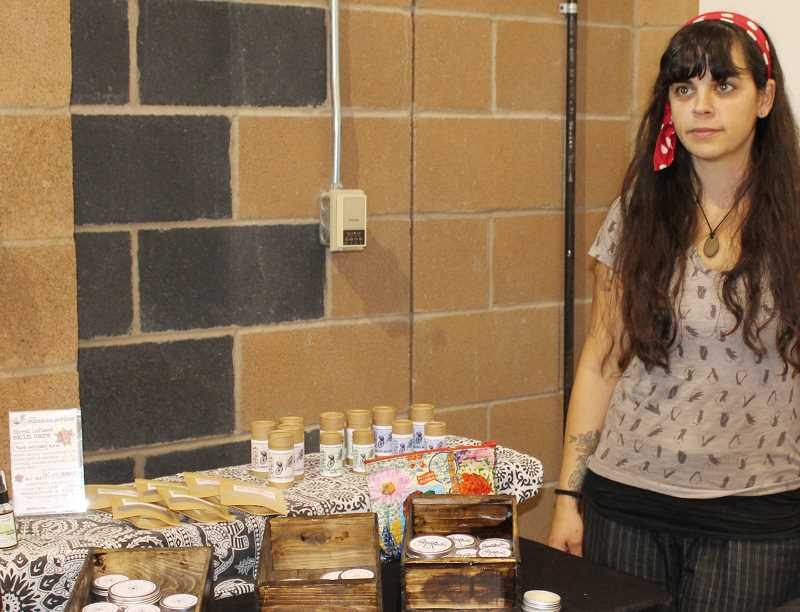 HOLLY M. GILL/MADRAS PIONEER - Holli Papasodora displays her Bohemian Peddler herbal skin care products at the Sip & Shop.