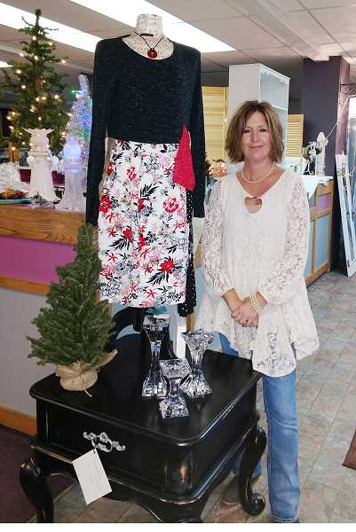 """SUBMITTED PHOTO - Lisa Zachary, who started the annual """"Angels in the Attic"""" boutique, displays wares at last year's event."""