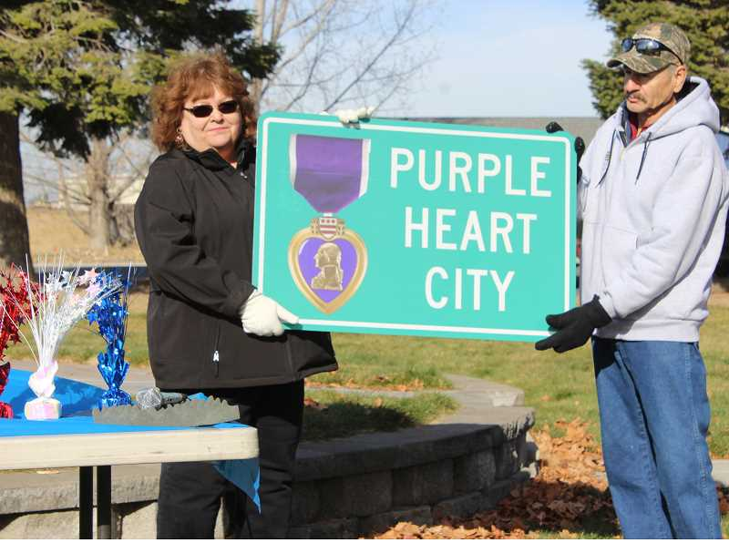 SUBMITTED PHOTO - Culver Mayor Nancy Diaz and Councilman Hilario Diaz hold the new signs that will be put up near the north and south entrances to the city of Culver.