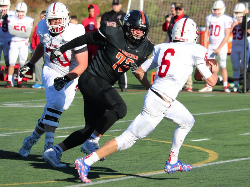 PAMPLIN MEDIA: JIM BESEDA - Gladstone's Jackson Simmons (72) was named the Tri-Valley League's Defensive Player of the Year for the second time in three seasons after leading the Gladiators to an undefeated league record.