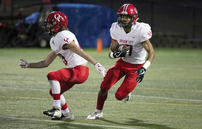 PAMPLIN MEDIA: JIM BESEDA - Oregon City's Zakayas Dennis-Lee (right) was named to the all-Three Rivers League football first team at three positions -- running back, linebacker, and kick returner.