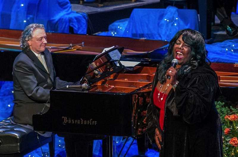 SUBMITTED PHOTO  - Michael Allen Harrison and Julianne Johnson bring the holiday music to Lake Theater and Cafe Nov. 26 as part of the Music Monday concert series. They will present songs in the spirit of the holidays.