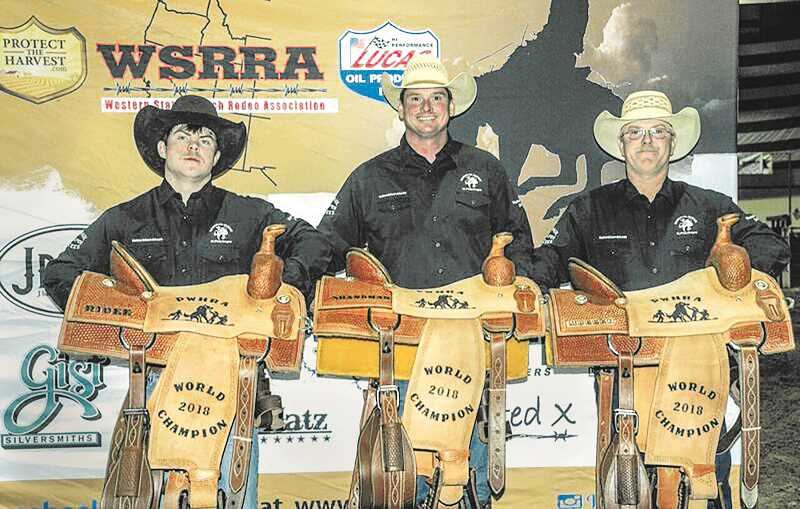 SUBMITTED PHOTO - St. Paul's David Gregory (middle) poses with teammates Dakota Lyons (left) and Ricky Lyons (right) after winning the 2018 Professional Wild Horse Race Association World Championship.