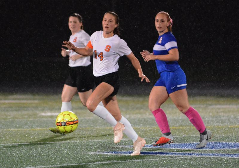 PAMPLIN MEDIA GROUP PHOTO: JIM BESEDA - Scappoose's Emma Jones, an all-conference junior midfielder, heads for the ball during a game against La Salle Prep.