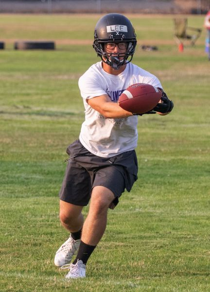 PAMPLIN MEDIA GROUP PHOTO: LOREN WOHLGEMUTH - St. Helens senior Shawn Lee practices his receiving in a preseason workout.