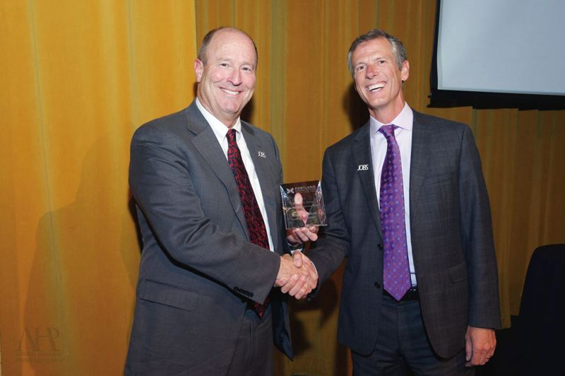PAMPLIN MEDIA GROUP: FILE - In 2015, Mitch Hornecker, right, who at the time was chair of the Portland Business Alliances Board of Directors, presented the Willliam S. Naito award to Bank of America Merril Lynch executive Roger Hinshaw.