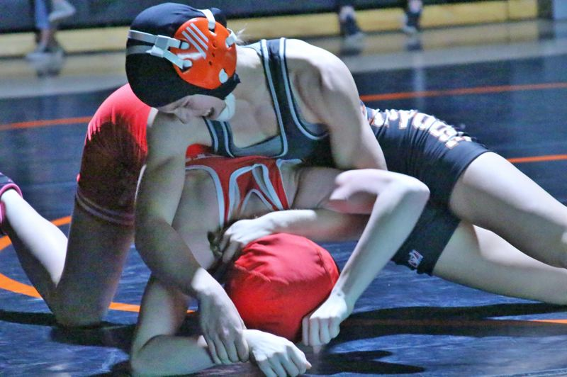 PAMPLIN MEDIA GROUP FILE PHOTO - Scappoose High wrestling's Emma Jones works over an opponent in a 2017-18 season match.