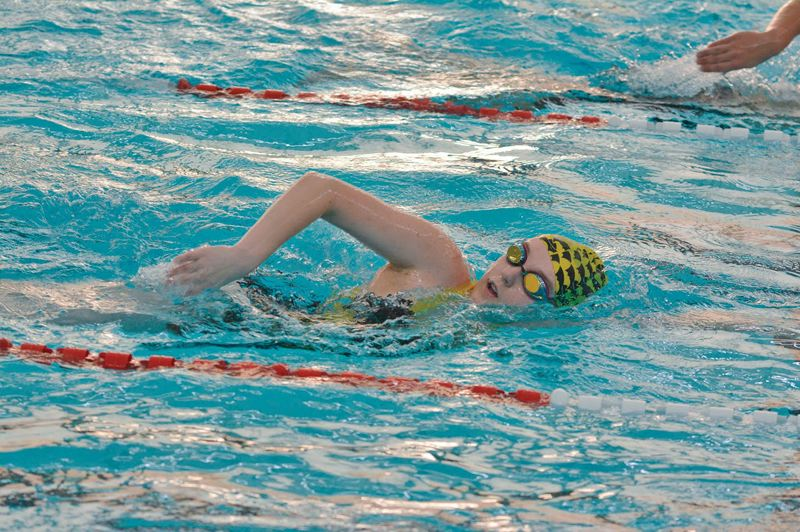 PAMPLIN MEDIA GROUP FILE PHOTO - St. Helens Lions swimmer Audra Lein heads to the wall during a meet last season.