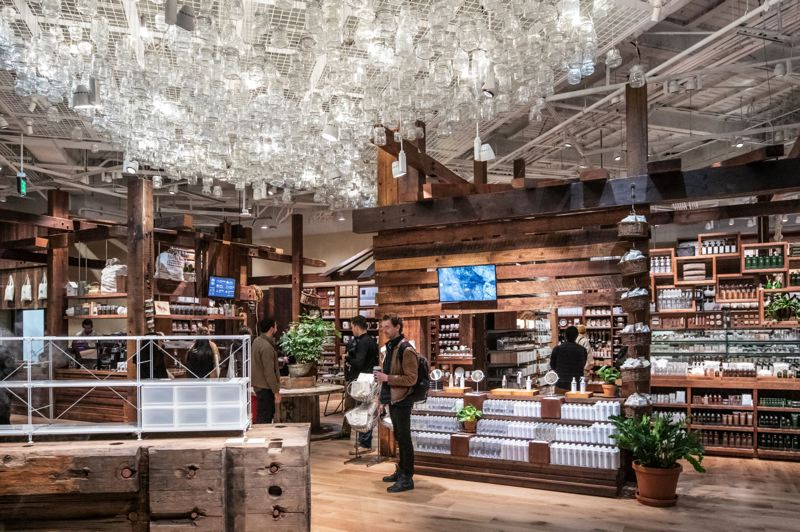 TRIBUNE PHOTO: JONATHAN HOUSE - The interior of Muji in the Meier & Frank Building features locally sourced wood, including 204 reclaimed old-growth timbers.