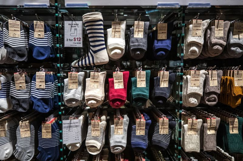 TRIBUNE PHOTO: JONATHAN HOUSE - Socks in a range of colors and styles complement sneakers and shoes sold at the store