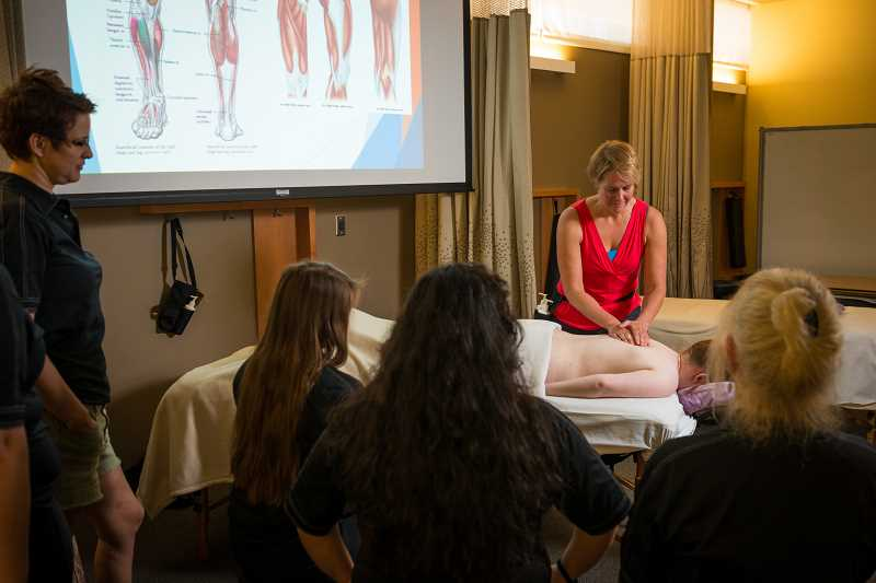 SUBMITTED PHOTO - An instructor demonstrates massage techniques.