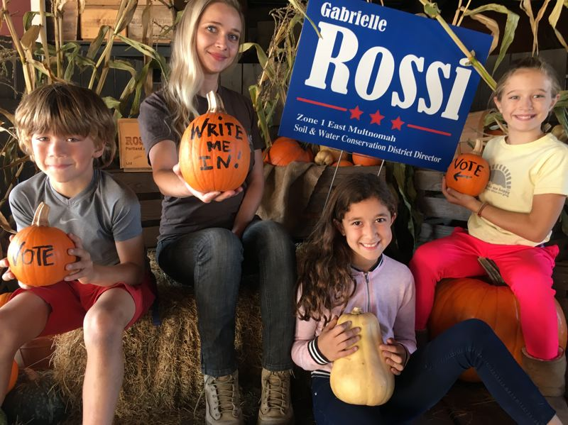 COURTESY OF KRIS THOMPSON - Gabrielle Rossi (second from left), shown here with her friends' children, appears to have won her write-in campaign for the board of the East Multnomah Soil and Water Conservation District.